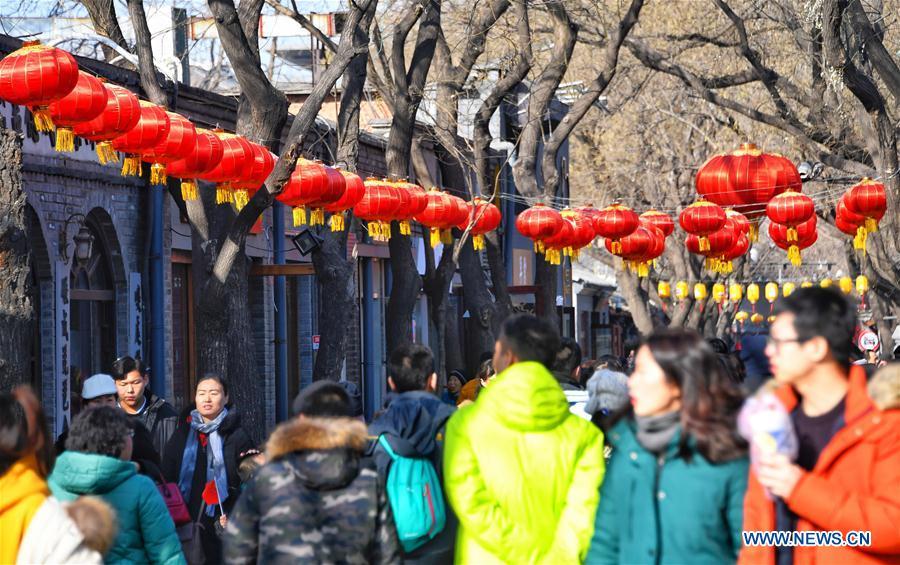 Tourists visit Nanluogu Alley in festive atmosphere in Beijing
