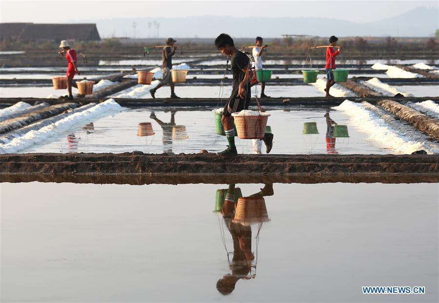 Farmers work in salt beds in Myanmar
