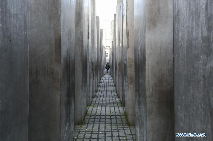 People visit Memorial to Murdered Jews of Europe in Berlin