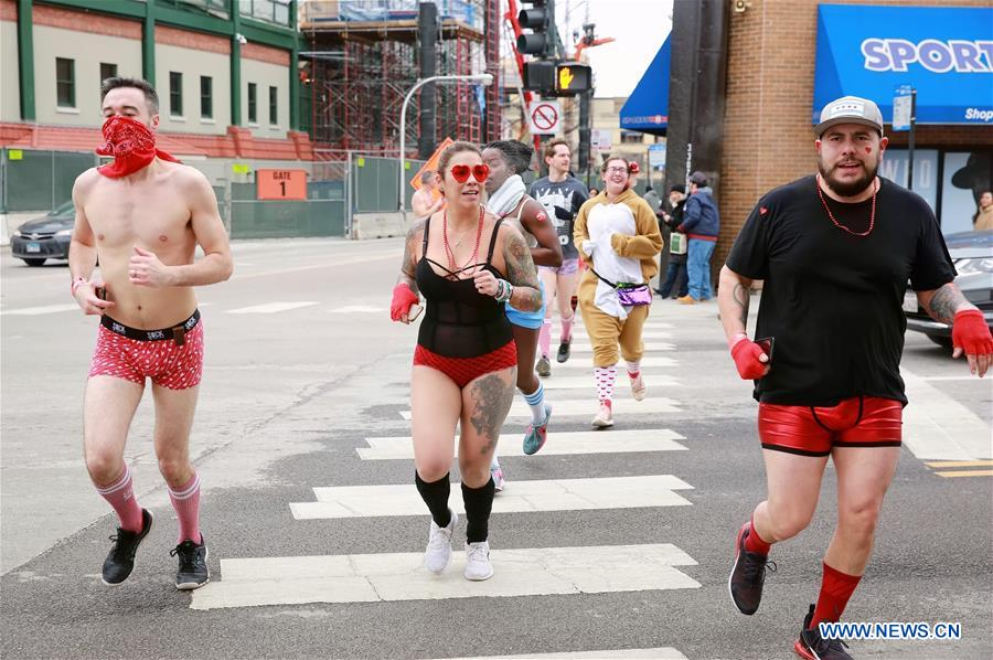 Runners in underwear participate in Cupid's Undie Run in Chicago