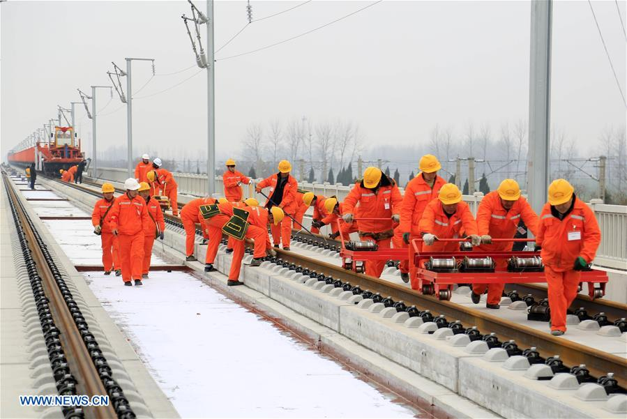 Workers lay track for Shangqiu-Hefei-Hangzhou high-speed railway