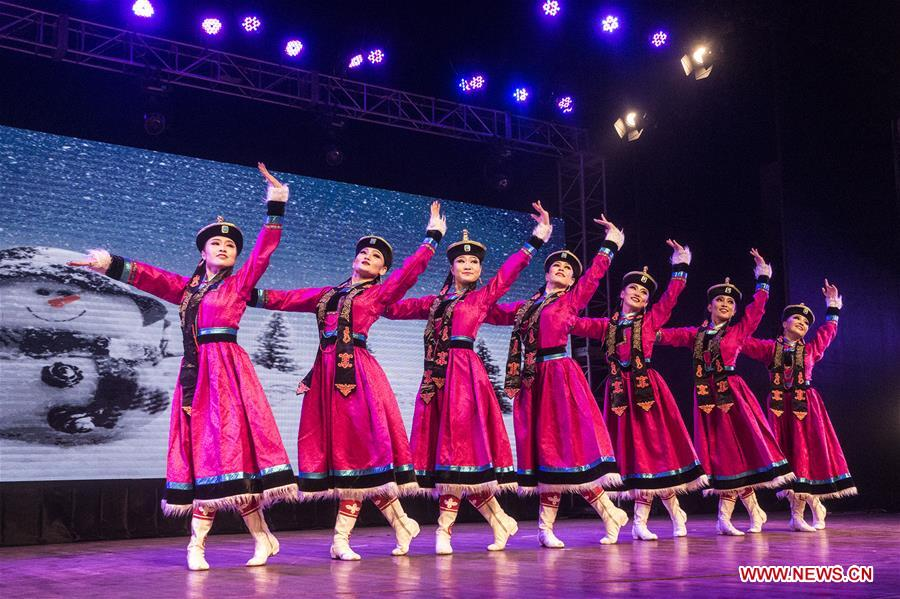 Dancers from China perform during Lunar New Year celebration in India