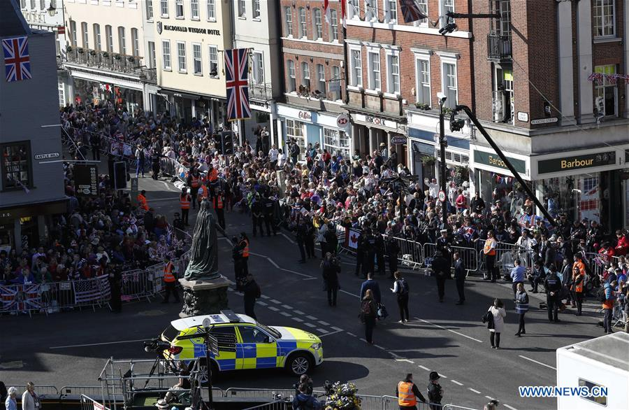 Well-wishers gather outside Windsor Castle for royal wedding in Britain
