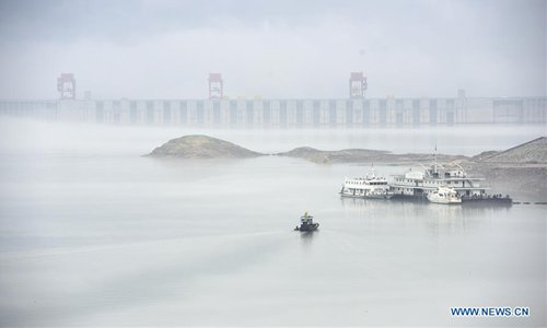 Fog-shrouded Three Gorges Dam area in central China's Hubei