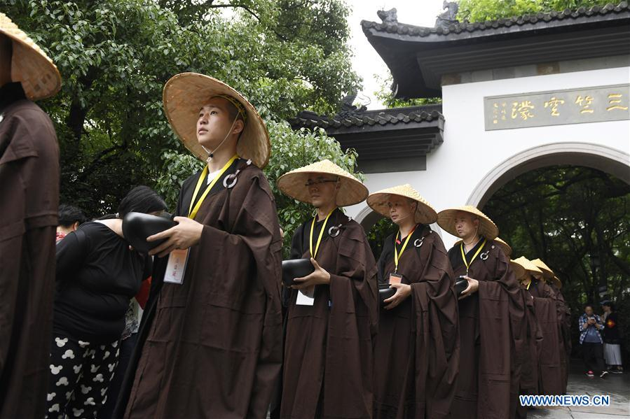 Monks participate in traditional mendicants' walk