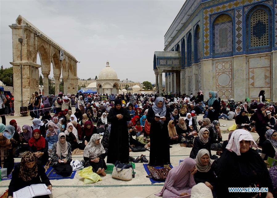 Muslim worshippers pray during Ramadan in Old City of Jerusalem