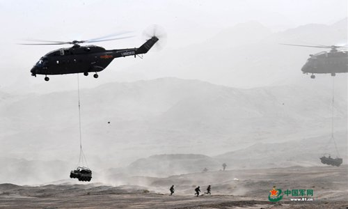 PLA ground forces conduct live-fire training in Xinjiang's Gobi Desert