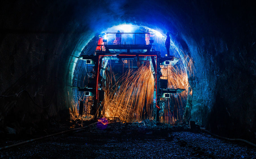 Freight rail tunnel breaks through early