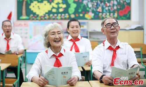 Elderly people in Children's Day costumes