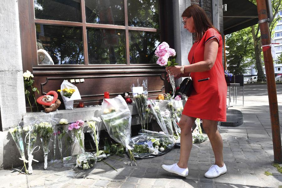 Locals mourn deceased shooting victims in Belgium