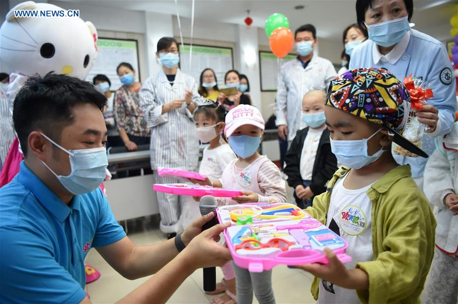 Children with leukemia participate in role play game as doctors in Chongqing, SW China