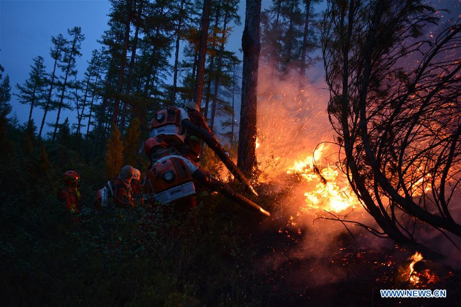 Nearly 2,000 people battling forest fires in north China