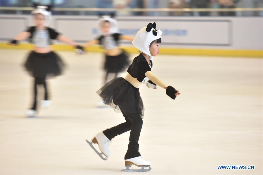 Children skate during figure skating contest in Fuzhou, SE China's Fujian