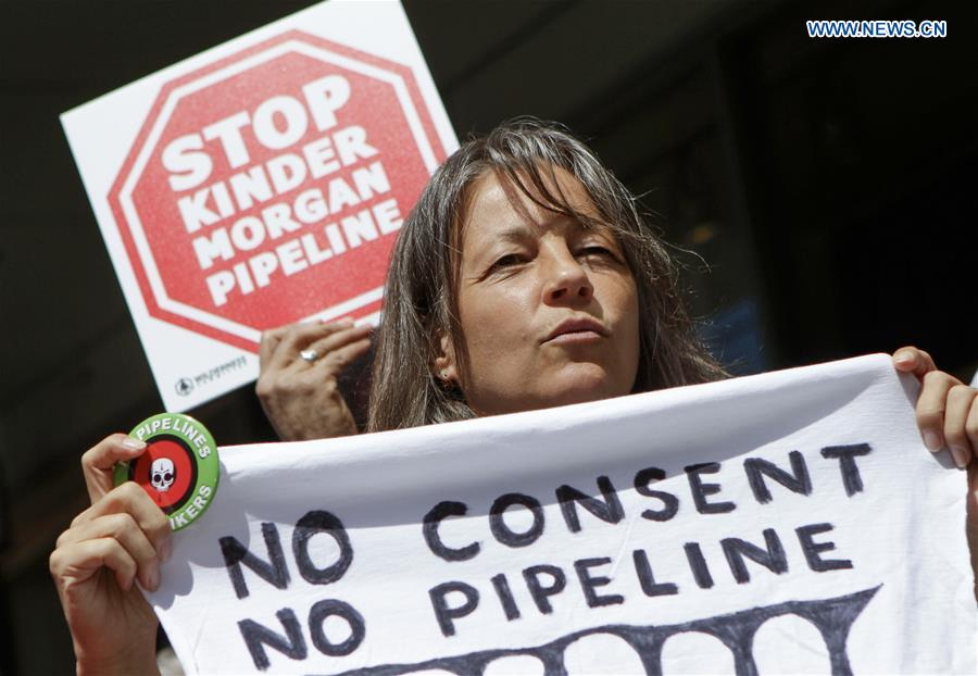 People protest against Trans Mountain pipeline expansion project in Vancouver, Canada