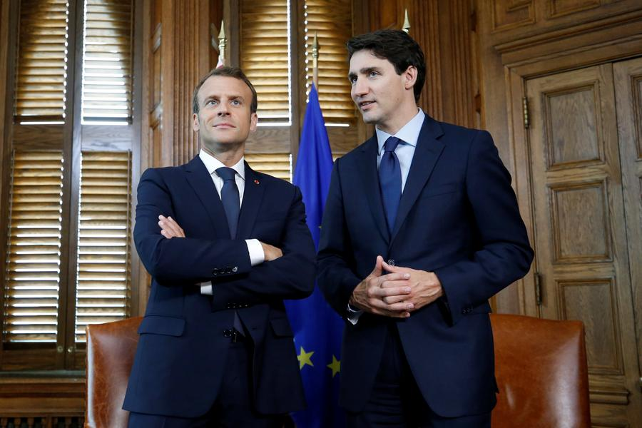 French president begins first visit to Canada
