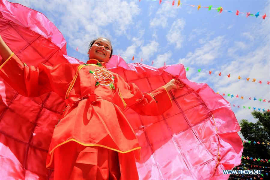 Folk culture celebration held in Hemu Town, south China's Guangxi