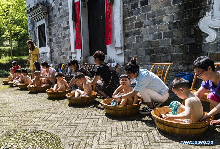 Folk custom activity held in China's Hubei to greet upcoming Dragon Boat Festival