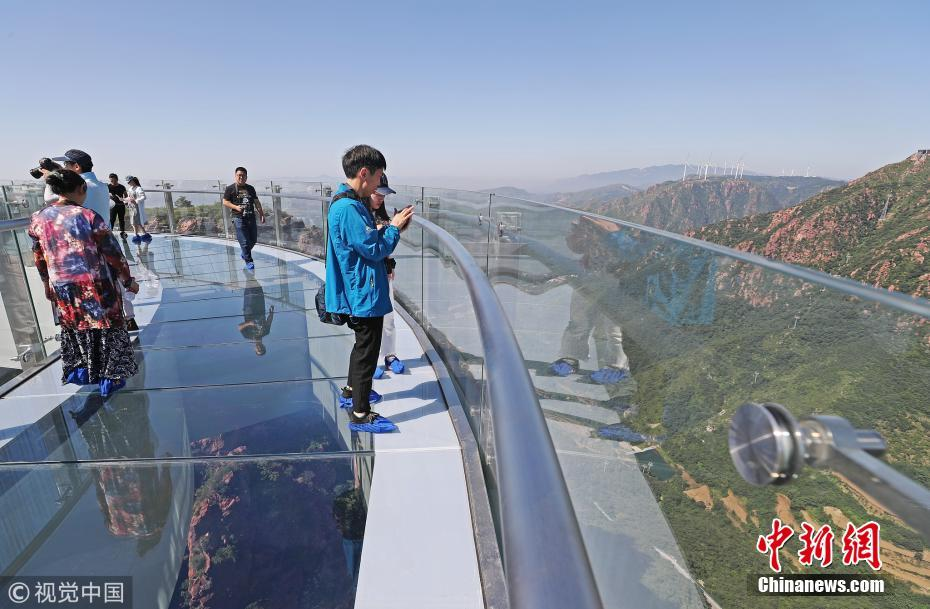 An aerial photo shows a cantilevered glass bridge on Fuxi Mountain in Henan Province of China