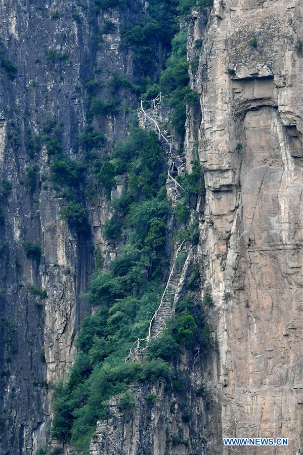 Cliff road helps villagers cast off poverty in N China's Shanxi