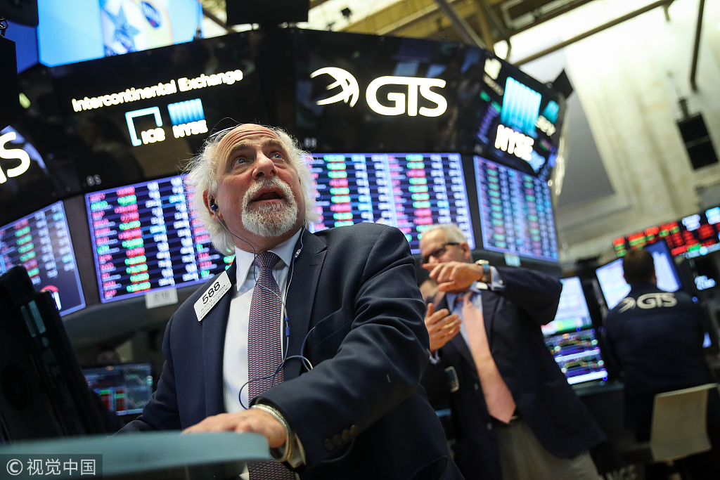 US stocks trade mixed after Fed hikes rates