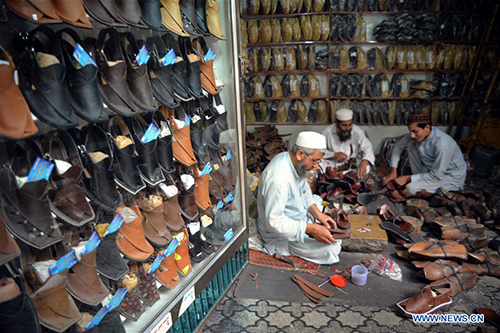 Shoemakers make traditional shoes to prepare for upcoming Eid al-Fitr in Pakistan