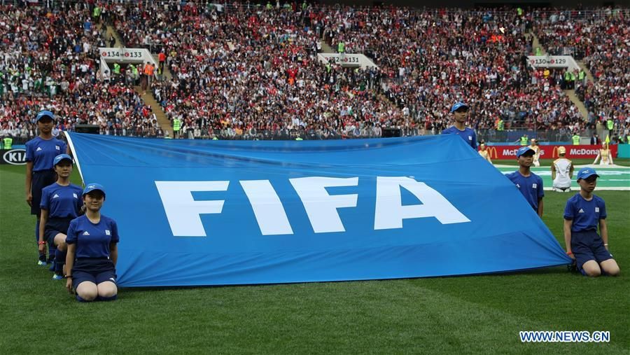 Chinese caddies hold FIFA flag before opening match of 2018 FIFA World Cup