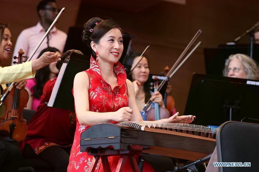 Chinese folk musicians perform with Chicago Jazz Philharmonic Orchestra