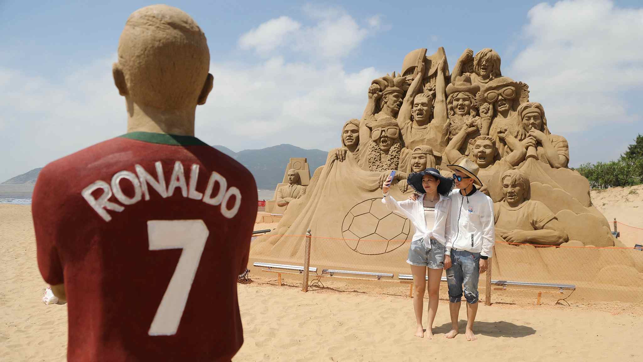 World Cup-themed sand sculptures woo crowd