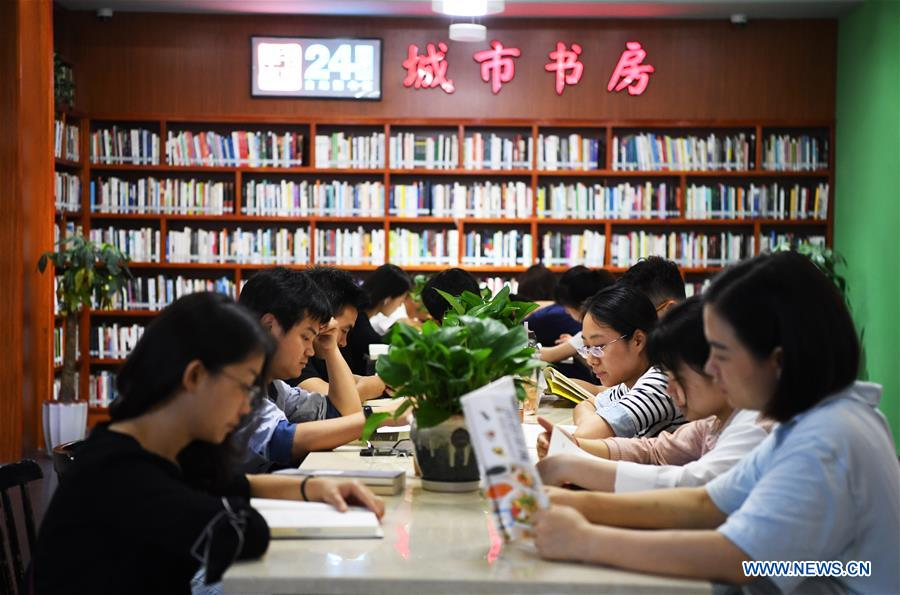 People read books at bookstore in southwest China's Chongqing