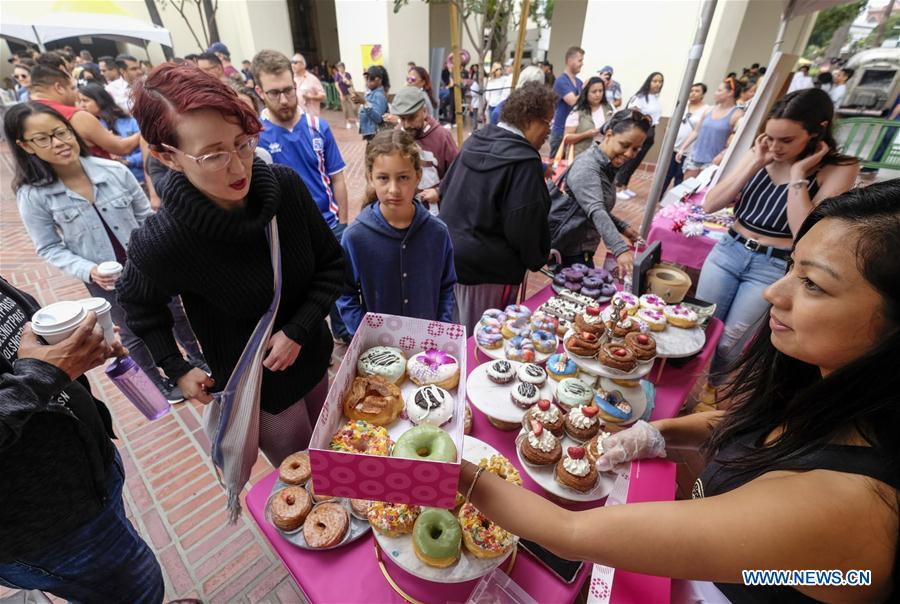 Variety of donuts displayed at DTLA Donut Festival in Los Angeles