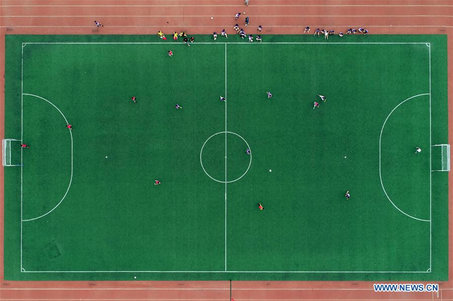 Pupils compete in football match in N China's Hebei