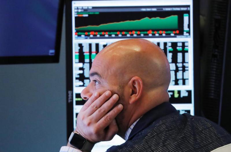 Wall Street slides, Dow erases 2018 gains as trade spat intensifies