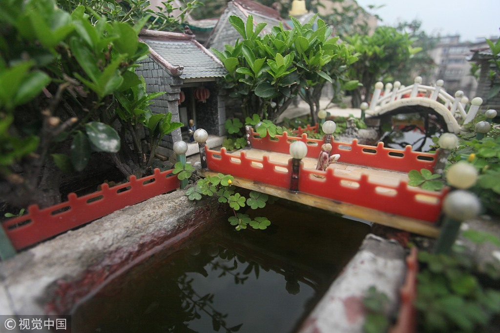 A retired man use convenience chopsticks to make miniature landscape works