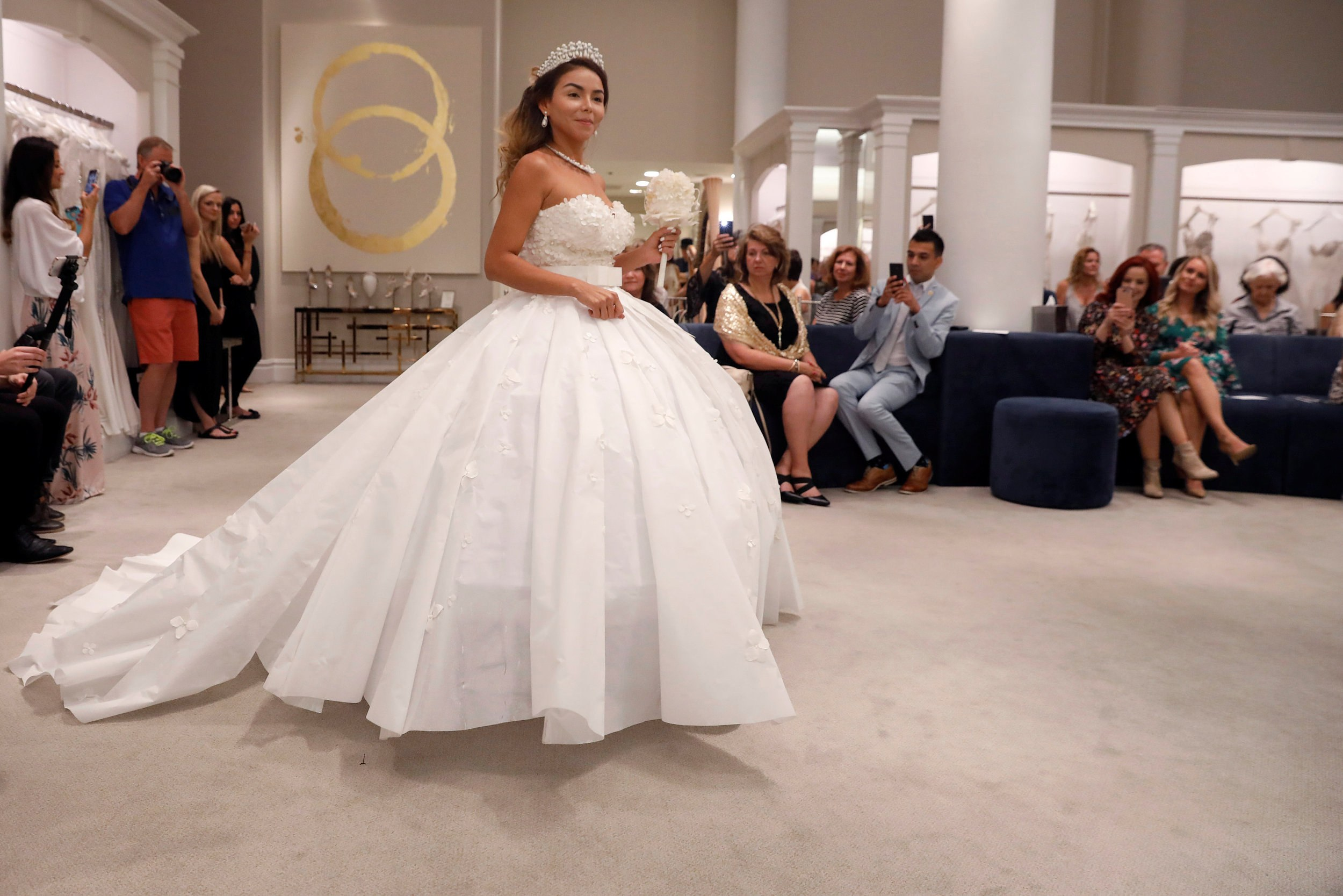 Designers roll out wedding dresses made of toilet paper in NY