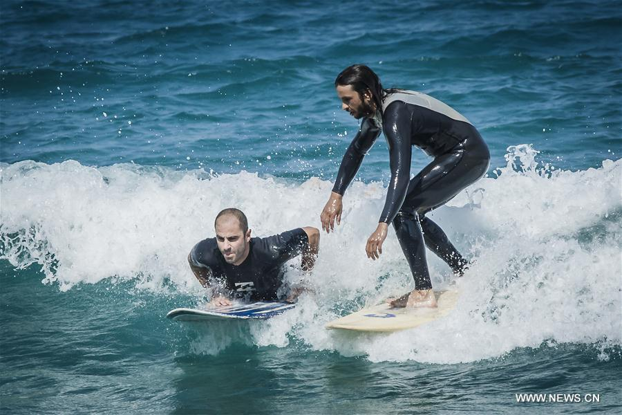 Greek surfers take on waves on Evia island