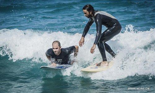 Greek surfers take on waves on Evia island