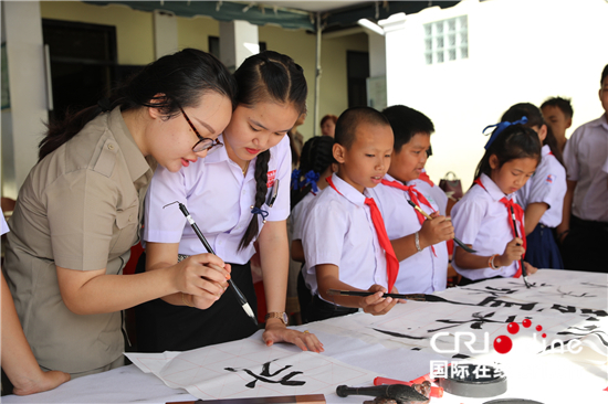 Students from Laos write brush calligraphy in Luang Prabang on Wednesday, July 4, 2018. [Photo: China Plus]