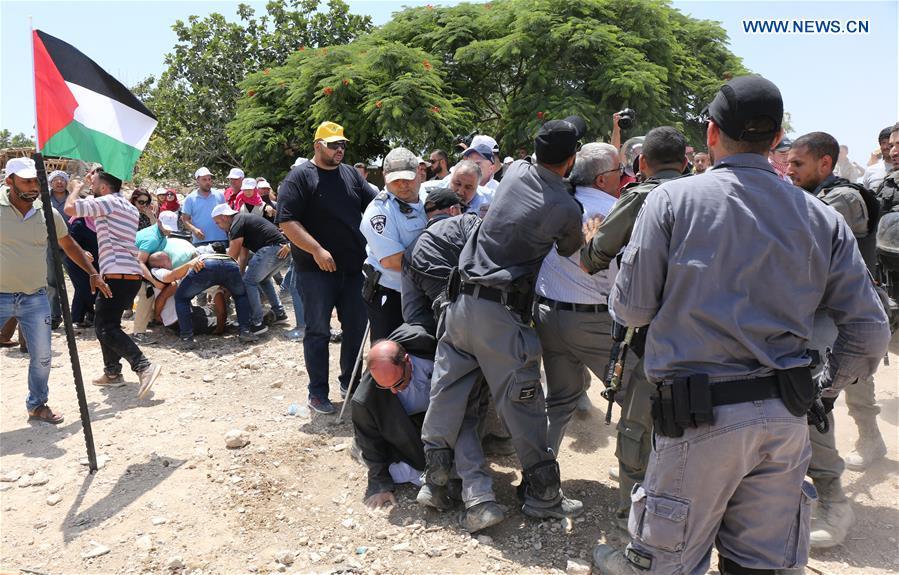 Israeli security forces clash with demonstrators protesting against Bedouin village demolition in East Jerusalem