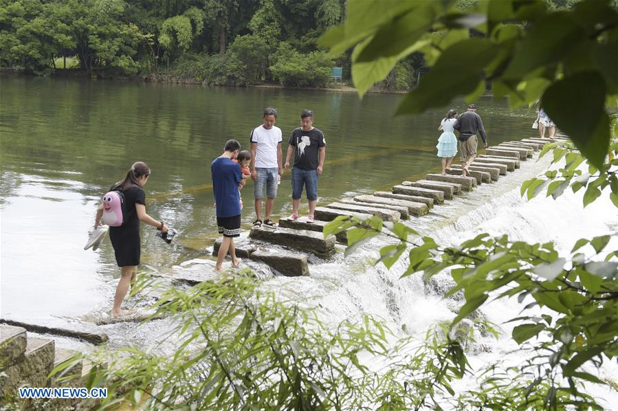 Tourists visit parks in Guiyang, SW China's Guizhou