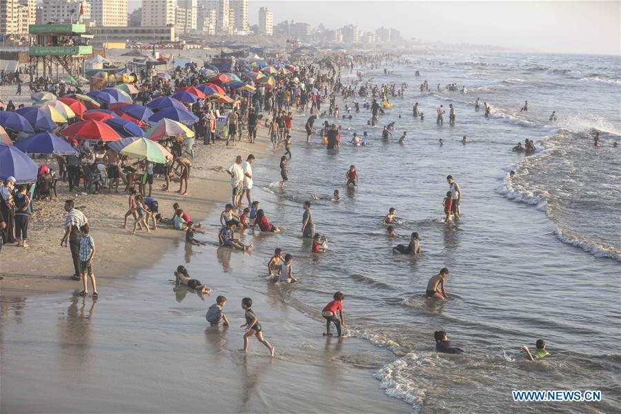 People enjoy themselves at beach in Gaza city