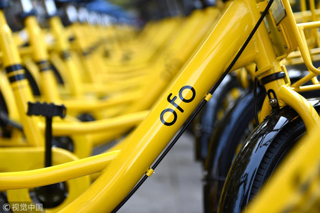 China-based ofo announced on Monday to suspend its bike-share scheme in U.S. third biggest city Chicago due to controversial locking rules. [File Photo: VCG]