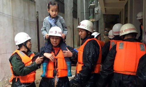 Rescuers evacuate residents as heavy rain hits NW China's Gansu