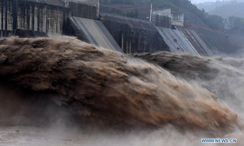 Water gushes out from Xiaolangdi Reservoir on Yellow River in C China's Henan