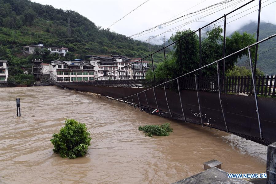 Intense downpours continue, causing floods in parts of Wenxian County, NW China