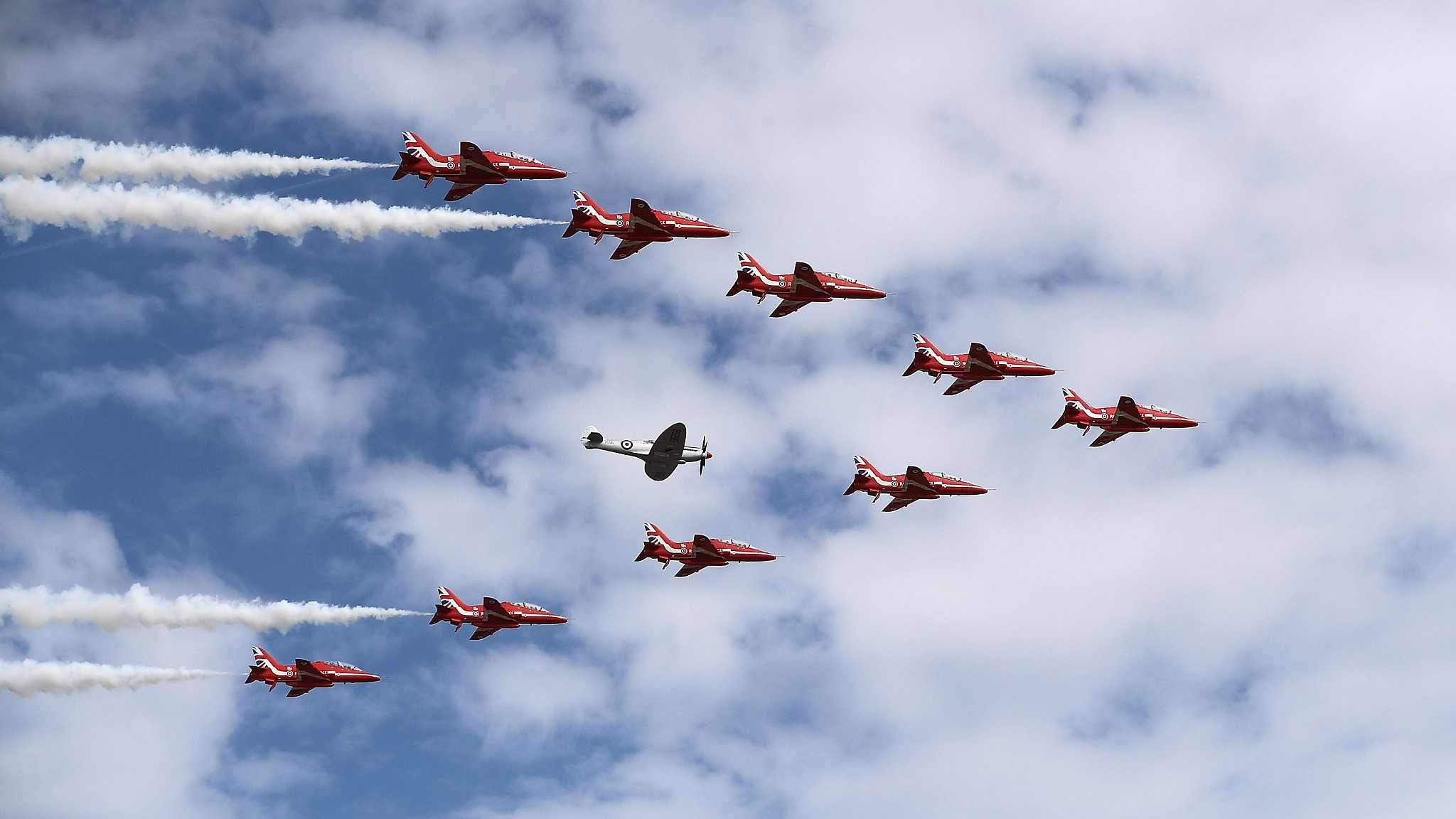 The Red Arrow performs at the opening of 2018 Farnborough Airshow in the UK