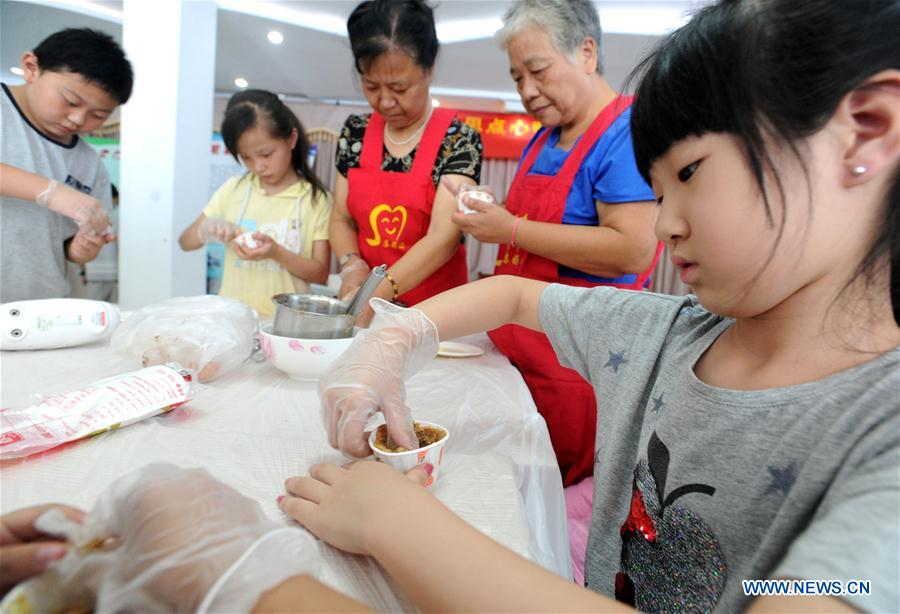 Students learn various skills during summer vacation across China