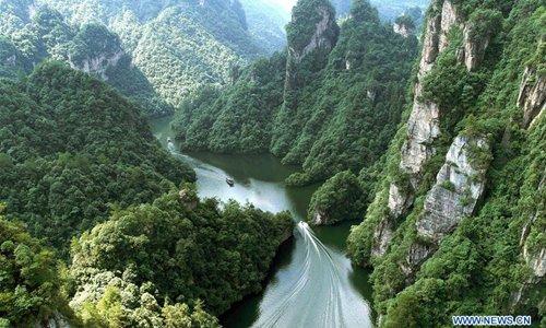 Tourists go sightseeing on boat in Zhangjiajie, China's Hunan