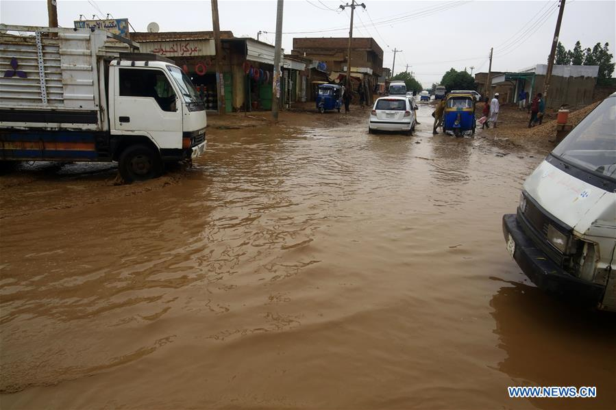 In pics: local citizens wade through rainwater in Khartoum, Sudan