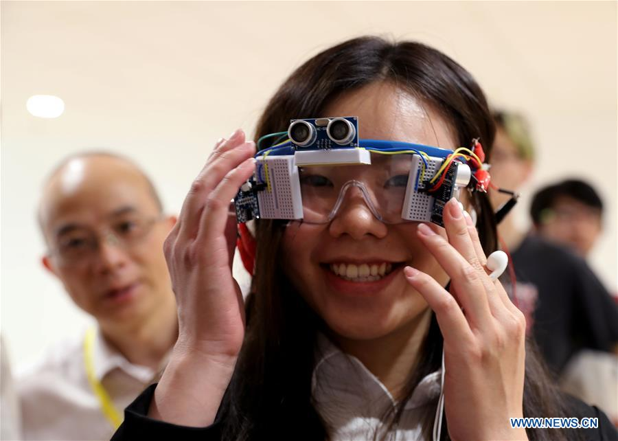 Creative designs on AI, internet displayed during design show in Shanghai