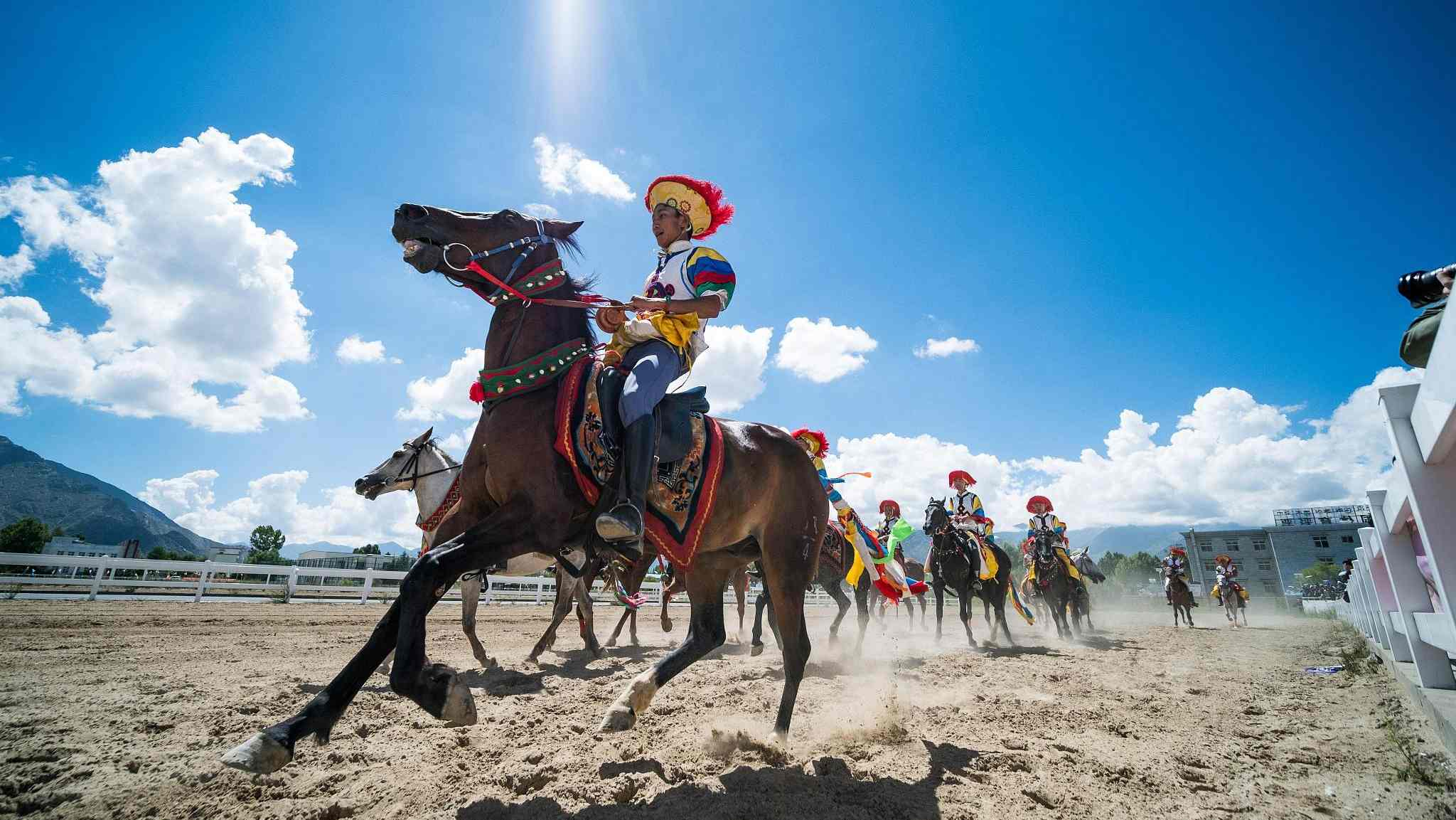 Horse riders perform stunts during Shoton Festival
